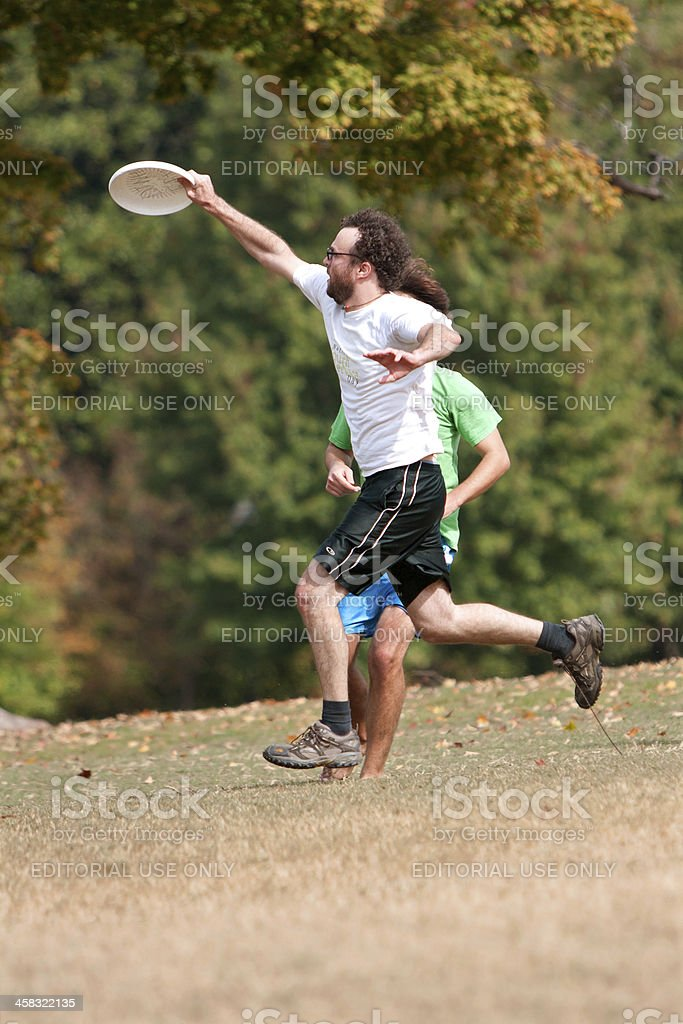 Man Jumps To Catch Frisbee In Park royalty-free stock photo