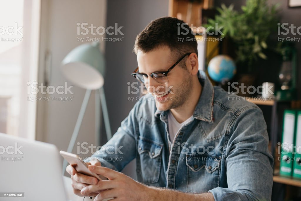 A man just read a funny text message on the phone stock photo