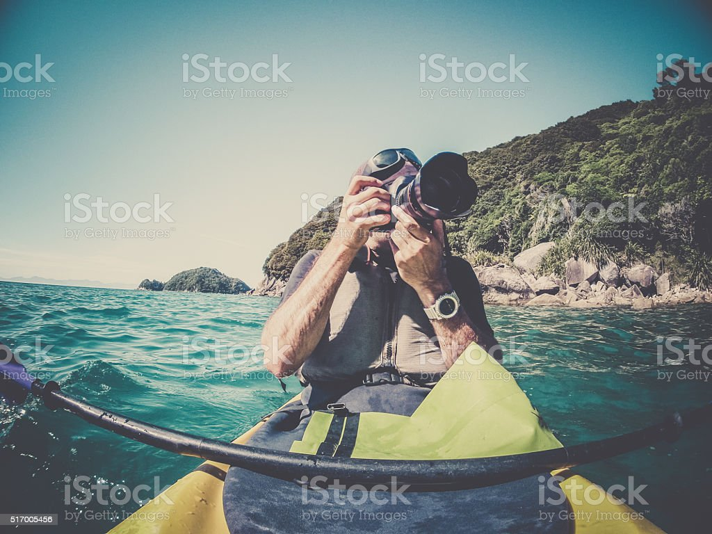POV Man Kayaking in Abel Tasman National Park, New Zealand stock photo