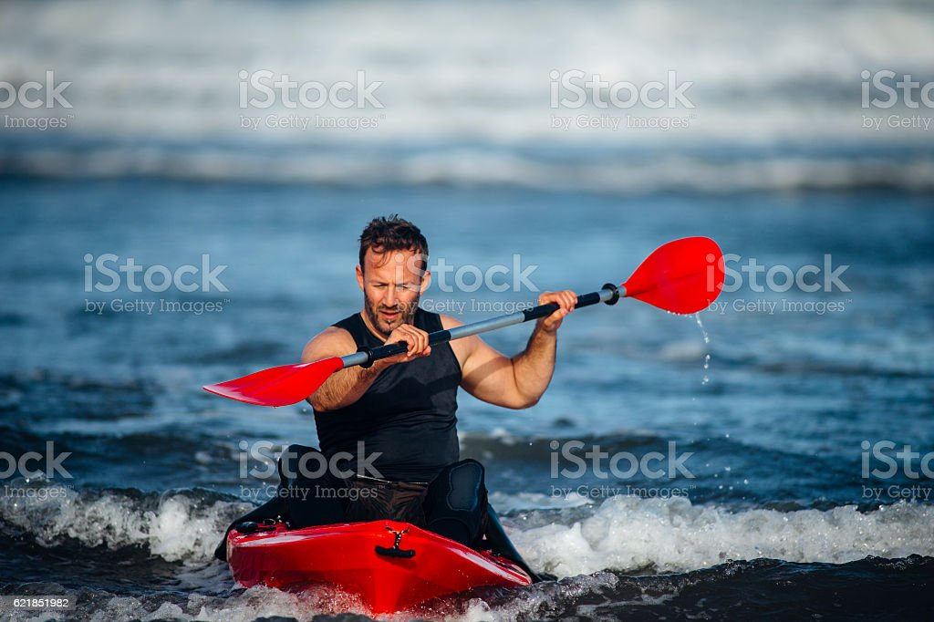 Man Kayaking in the Sea stock photo