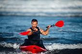 Man Kayaking in the Sea