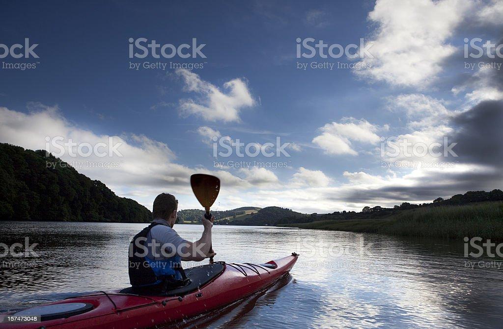 Man kayaking on a beautiful day stock photo