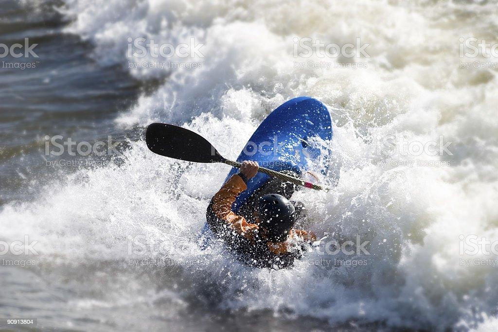 Man kayaking on Brennan's wave in Missoula Montana royalty-free stock photo