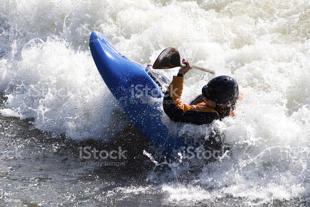 Man kayaking on Brennan's wave in Missoula Montana royalty-free stock photo