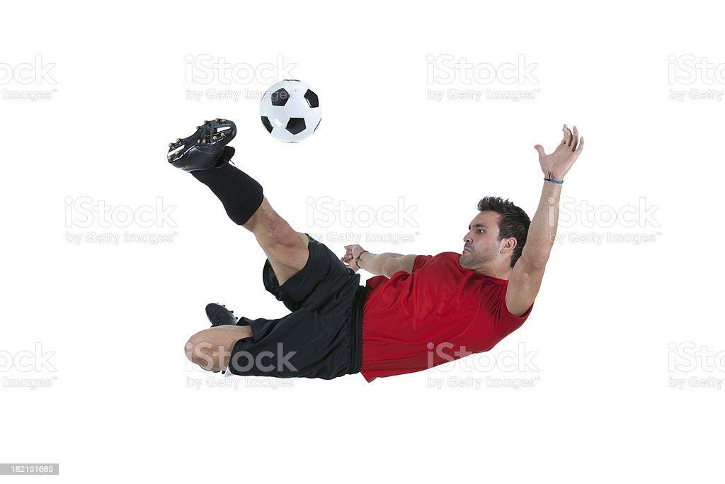 Man kicking a soccer ball royalty-free stock photo