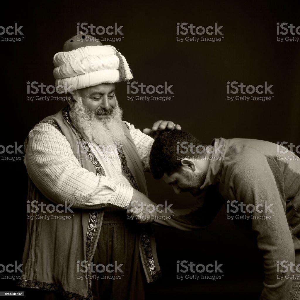 Man kissing a dervish's hand. stock photo