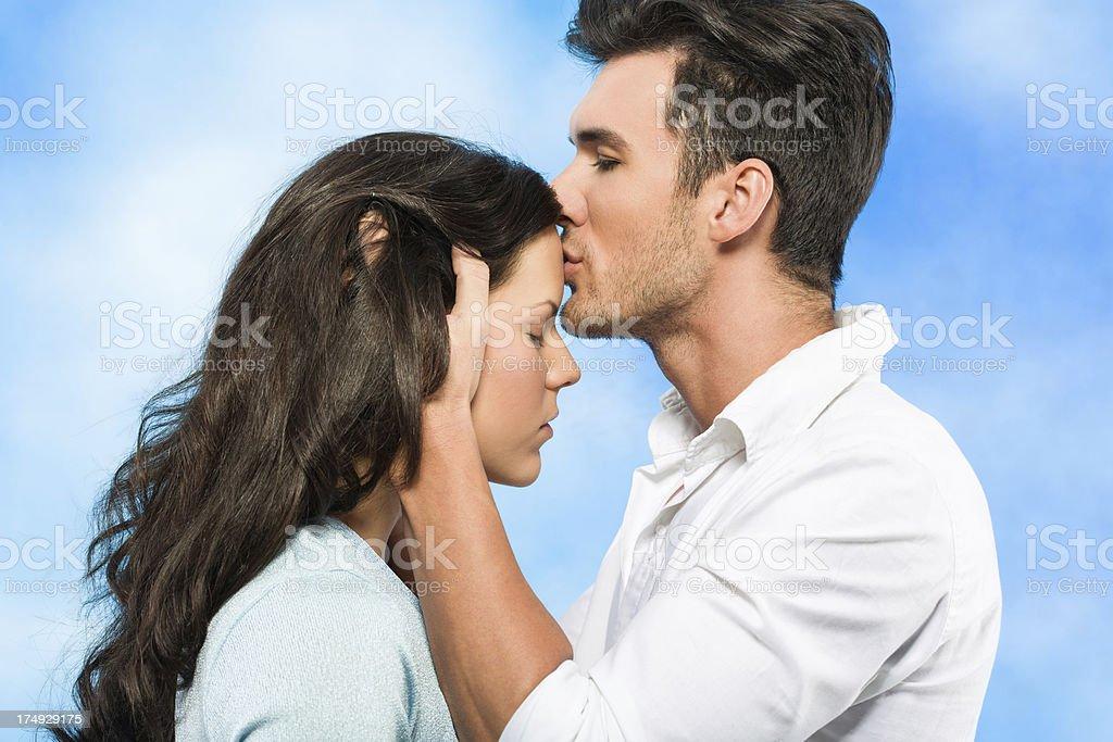 Man kissing a girl stock photo
