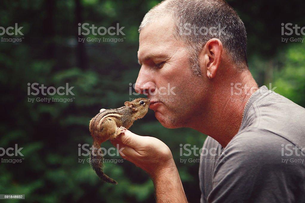 Man Kissing Chipmunk stock photo