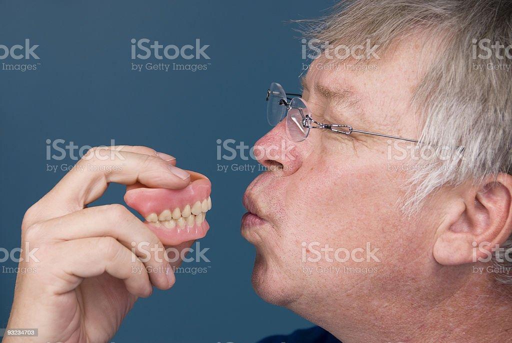Man kissing dentures royalty-free stock photo