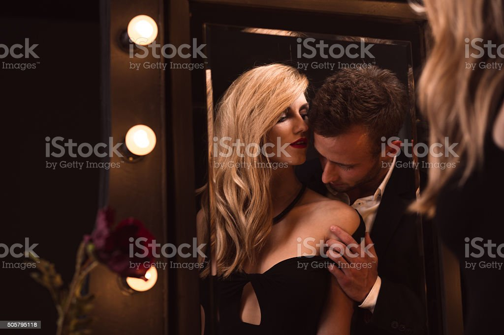 Man kissing his woman stock photo