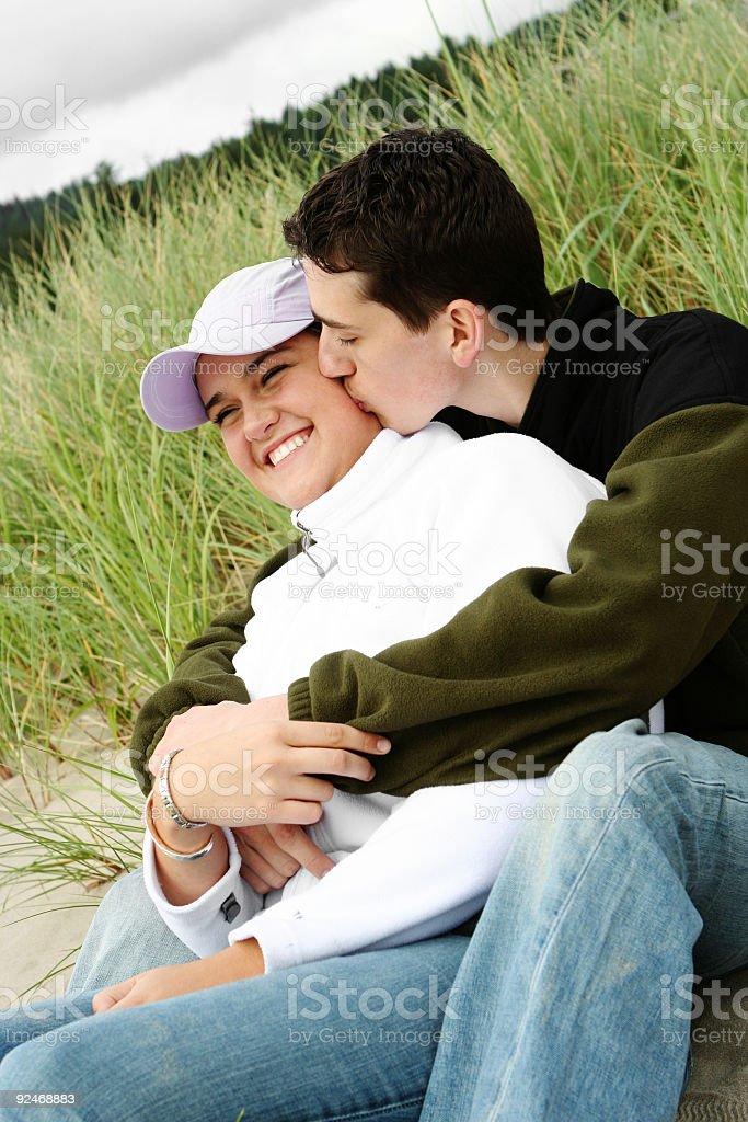 Man Kissing  Woman on the Cheek royalty-free stock photo