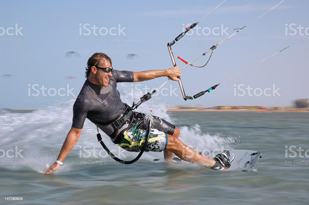 A man kiteboarding in action on a lake stock photo
