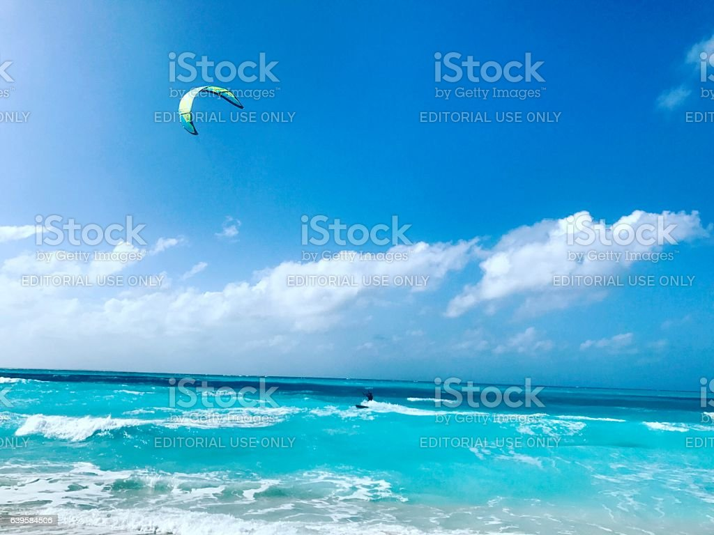 Man kitesurfing on Grace Bay Beach. Turks and Caicos Islands stock photo