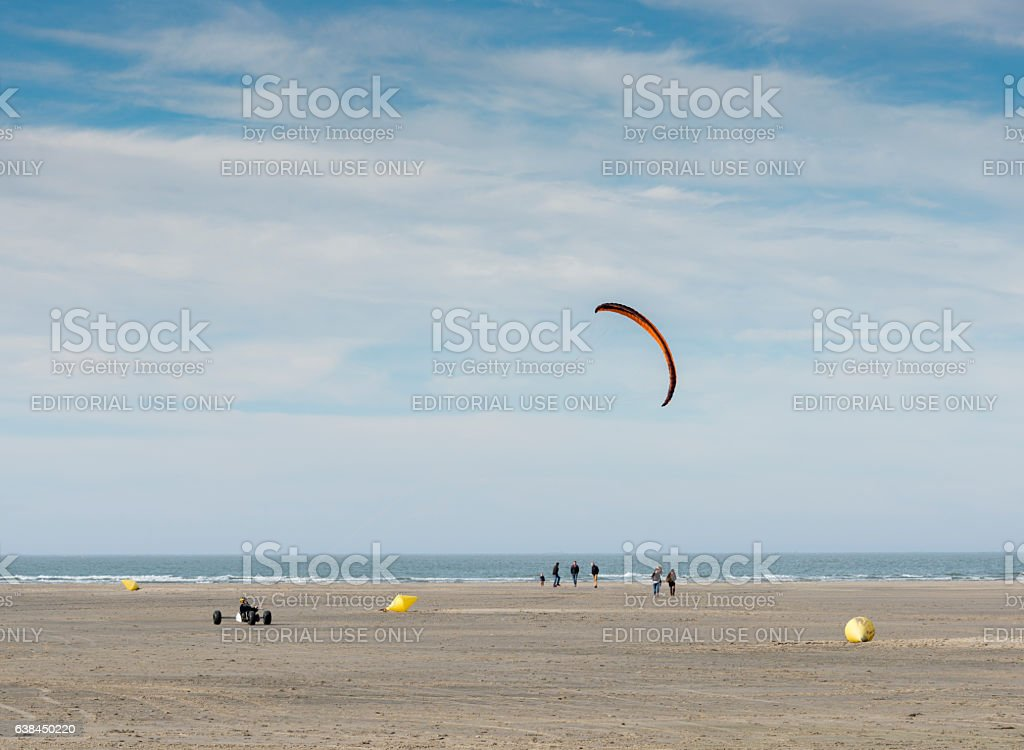 man kitesurfing on the beach in Ouddorp stock photo