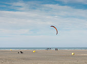 man kitesurfing on the beach in Ouddorp