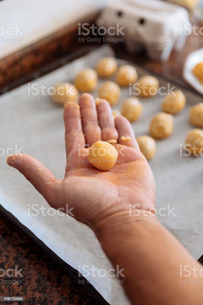 Man kneading marzipan for make panellets. stock photo