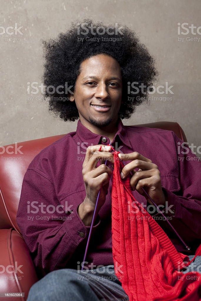 Man knitting a sweater stock photo