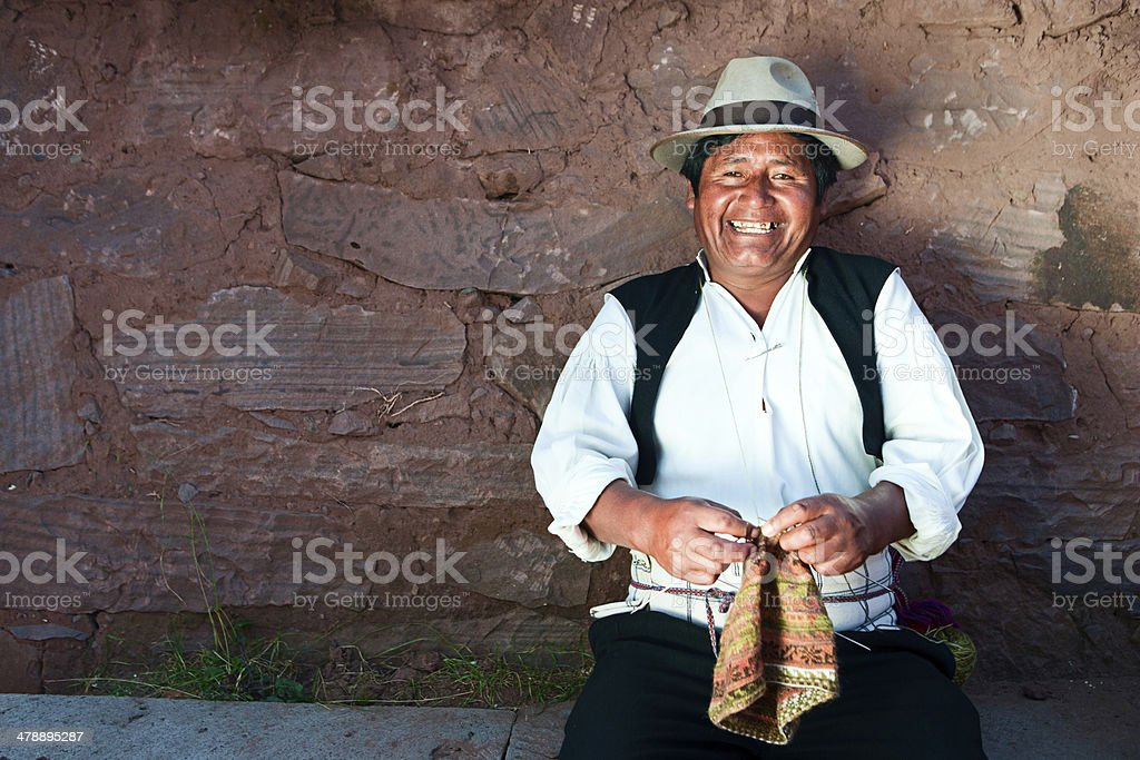 Man knitting on Taquile Island in Peru royalty-free stock photo
