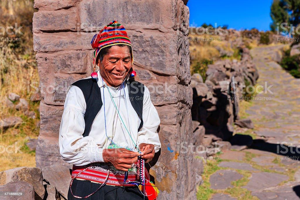 Man knitting on Taquile Island, Lake Titicaca, Peru royalty-free stock photo