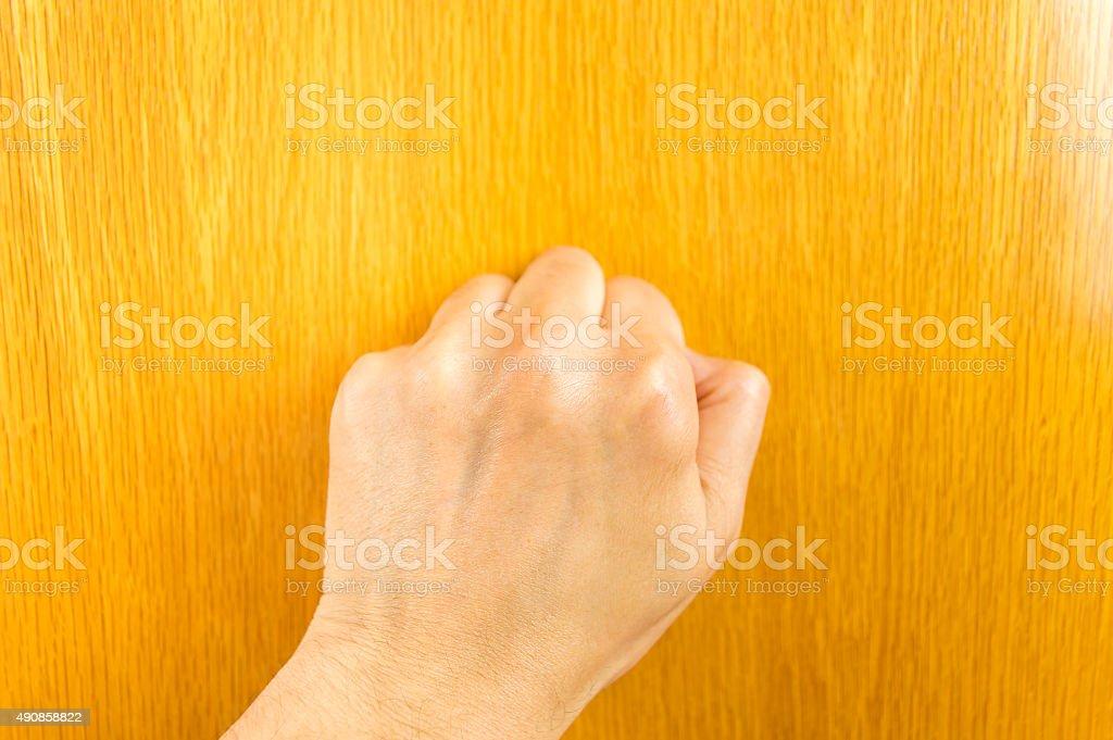 man knocking the door stock photo