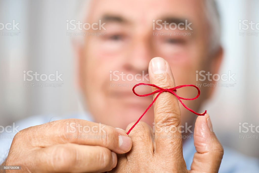 Man Knotting Rope For Memory stock photo
