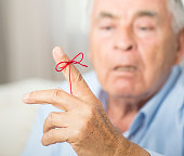 Man Knotting Rope For Memory
