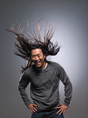 Man laughing, hair blowing in wind