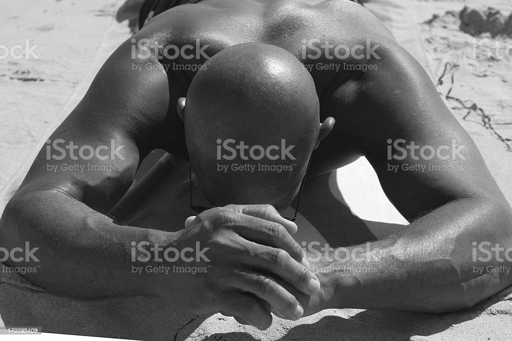 Man laying down flexing his muscles royalty-free stock photo