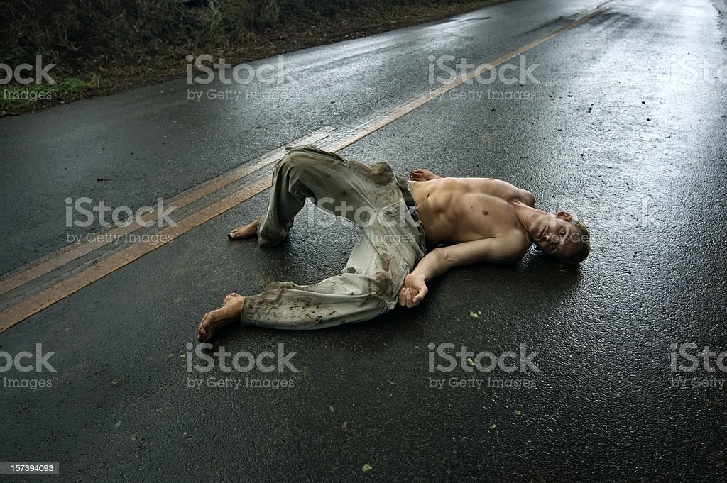 Man Laying On Road royalty-free stock photo