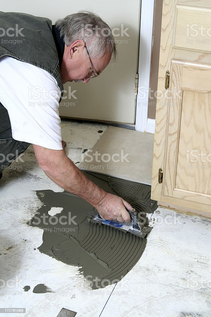 Man Laying Tile royalty-free stock photo