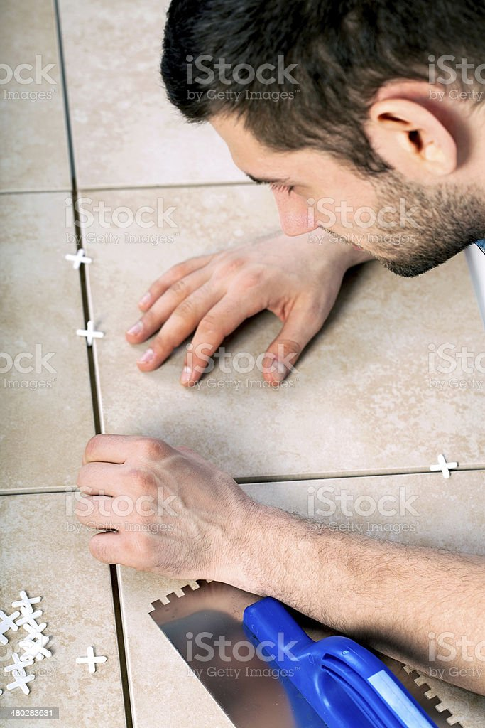 Man laying tiles royalty-free stock photo