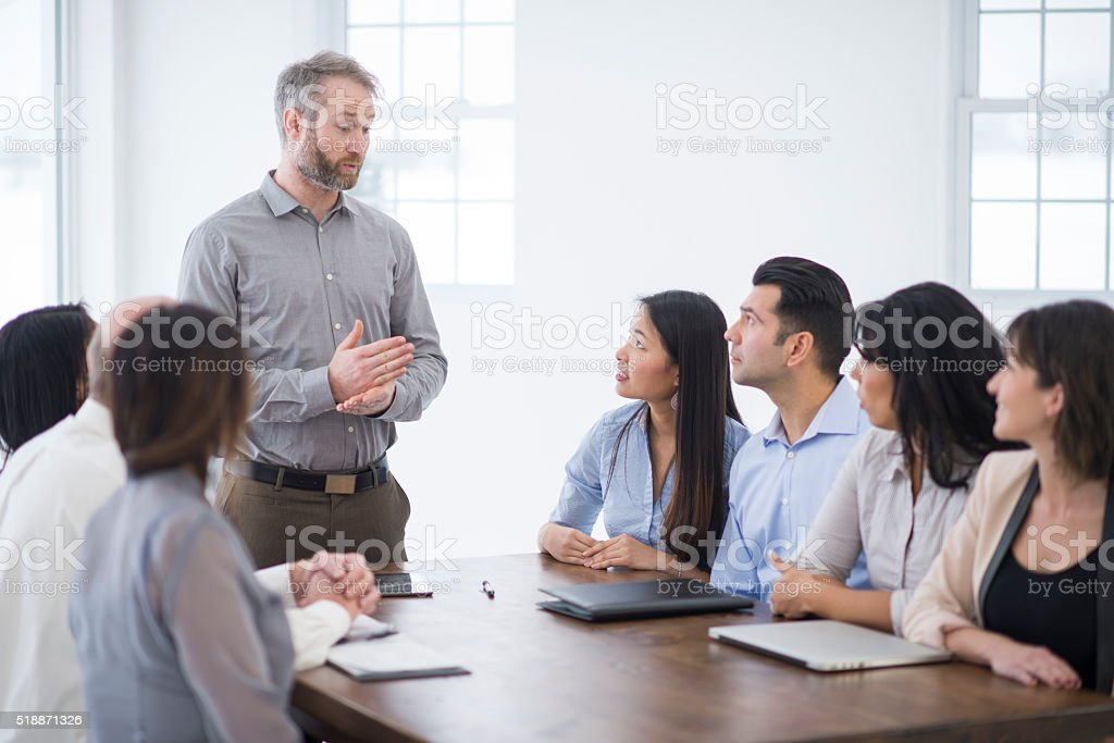 Man Leading a Meeting in the Boardroom stock photo