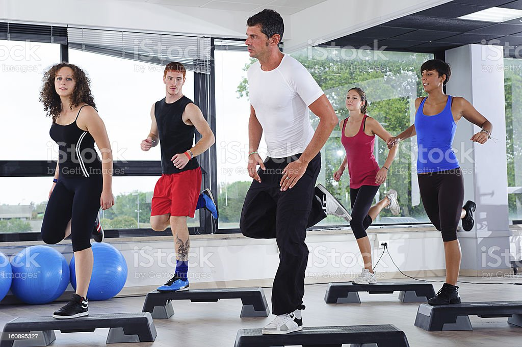 Man leading aerobics class in gym room royalty-free stock photo
