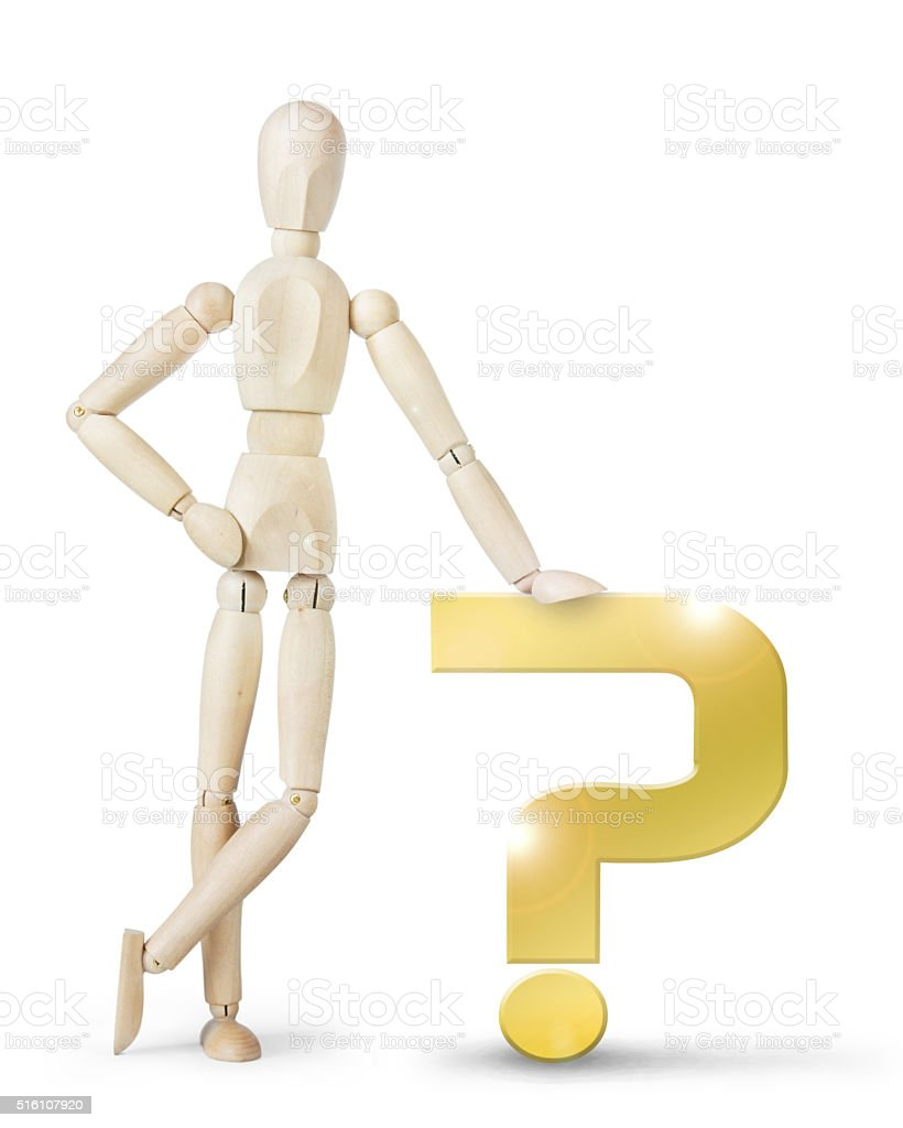 Man leaned against a large golden question mark stock photo