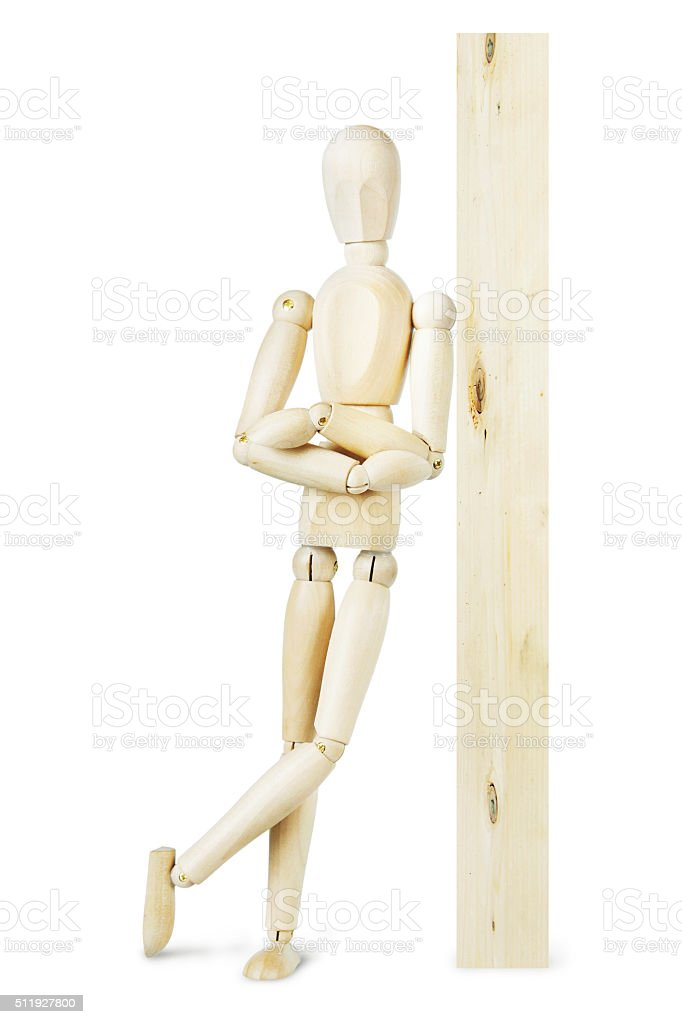 Man leaned against a wooden post stock photo