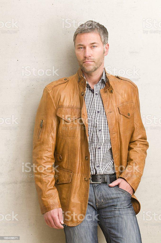 man leaning at wall royalty-free stock photo