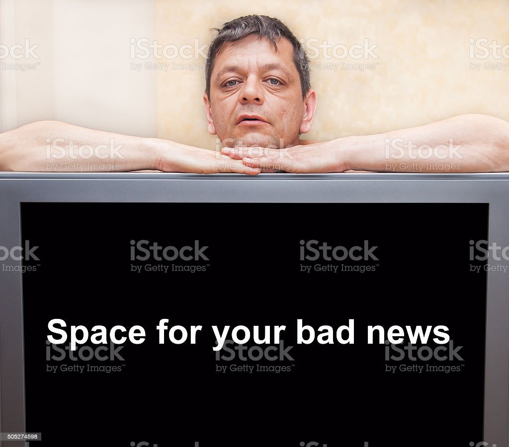 Man leaning on a black screen with space for text stock photo