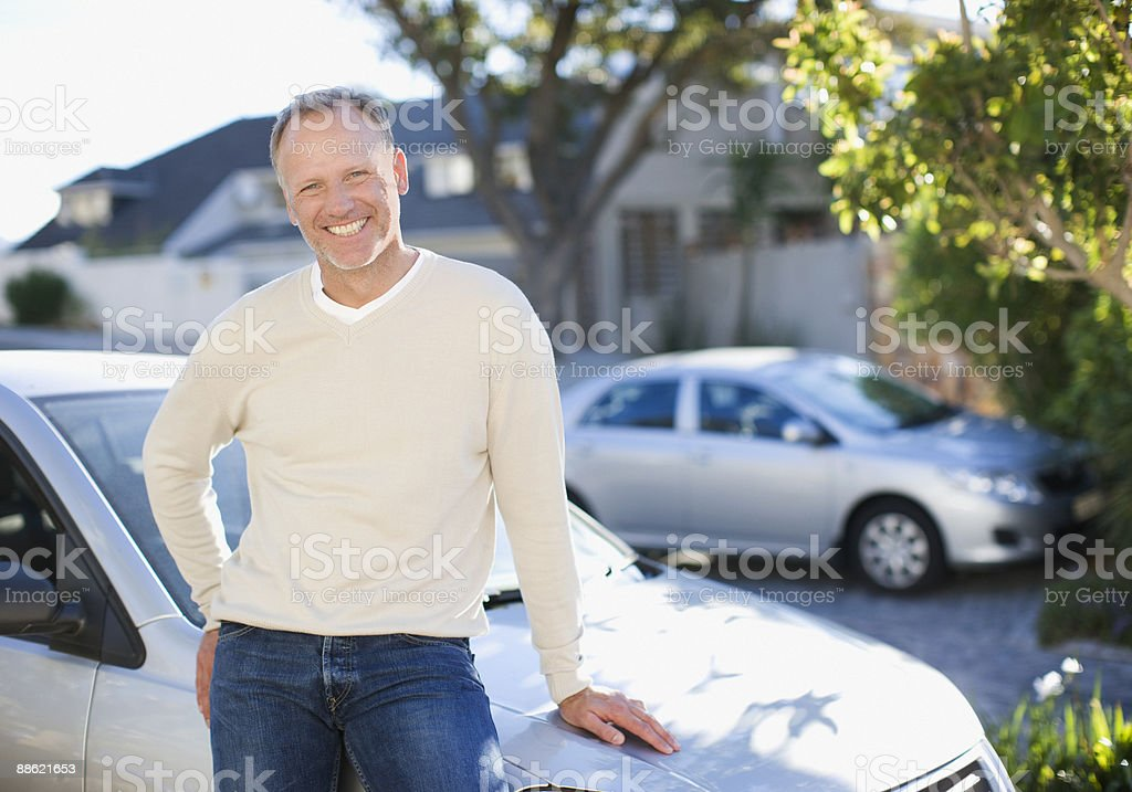 Man leaning on car hood royalty-free stock photo