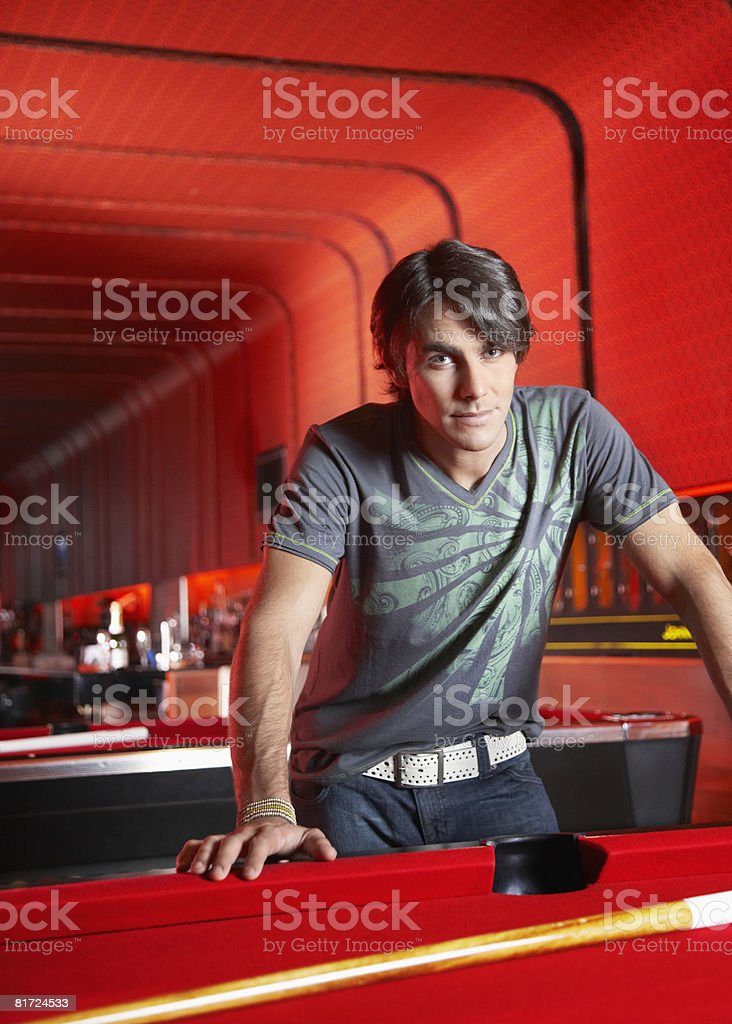 Man leaning on pool table royalty-free stock photo