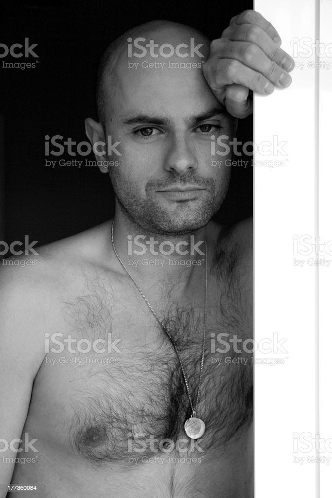 man leaning out of the window royalty-free stock photo