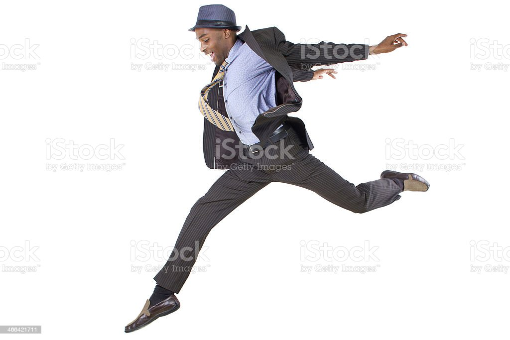 Man leaping in business clothes on white background stock photo