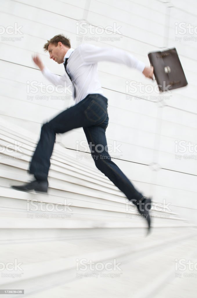 Man Leaps Up White Staircase with Briefcase royalty-free stock photo