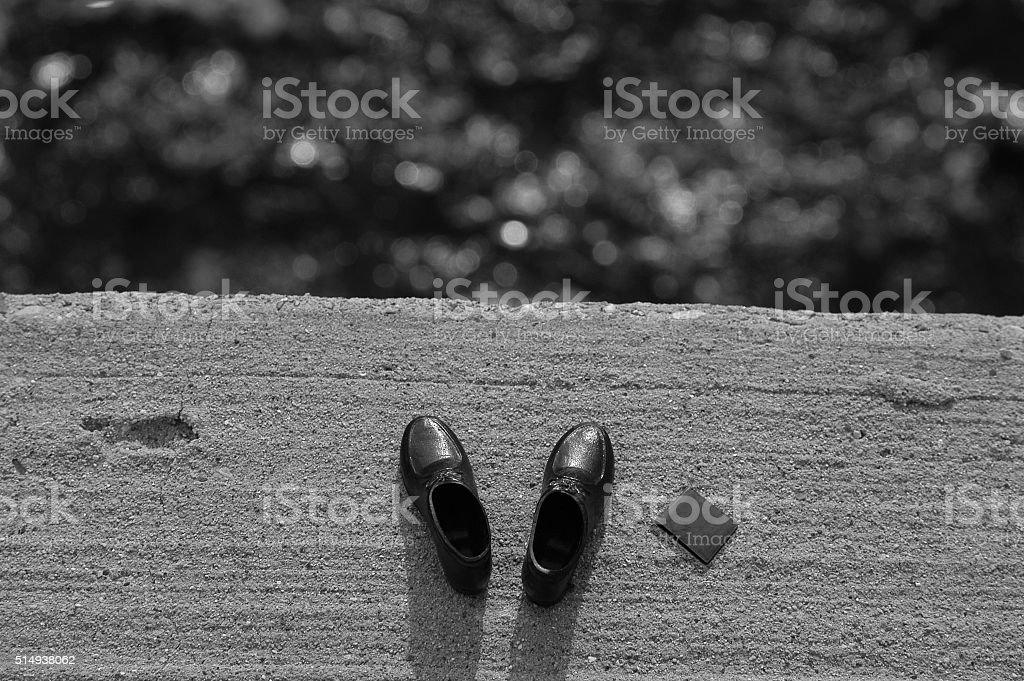 Man leaves shoes and wallet on bridge before jumping off stock photo