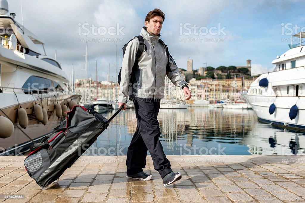 Man leaving yacht stock photo
