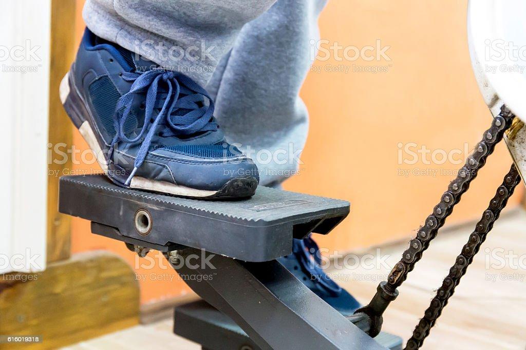 man leg on step machine stock photo