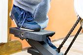 man leg on step machine