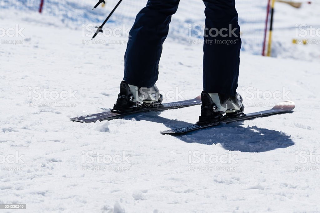 Man legs wear skiing equipment and prepare for extreme winter sports...