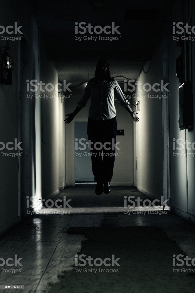 Man Levitating in Dark Hallway, royalty-free stock photo