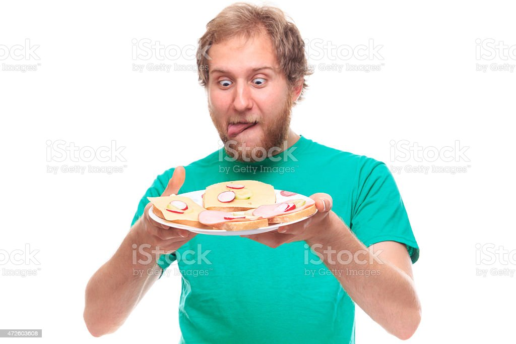 Man Lick one's lips with plate of eat stock photo