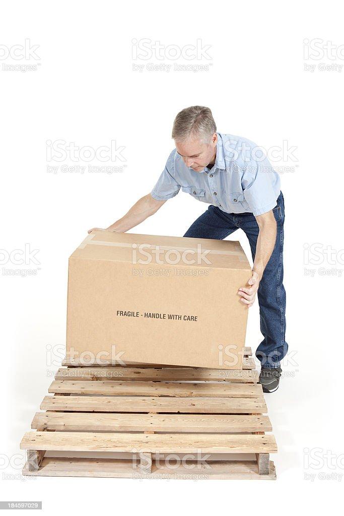 Man Lifting a Box royalty-free stock photo